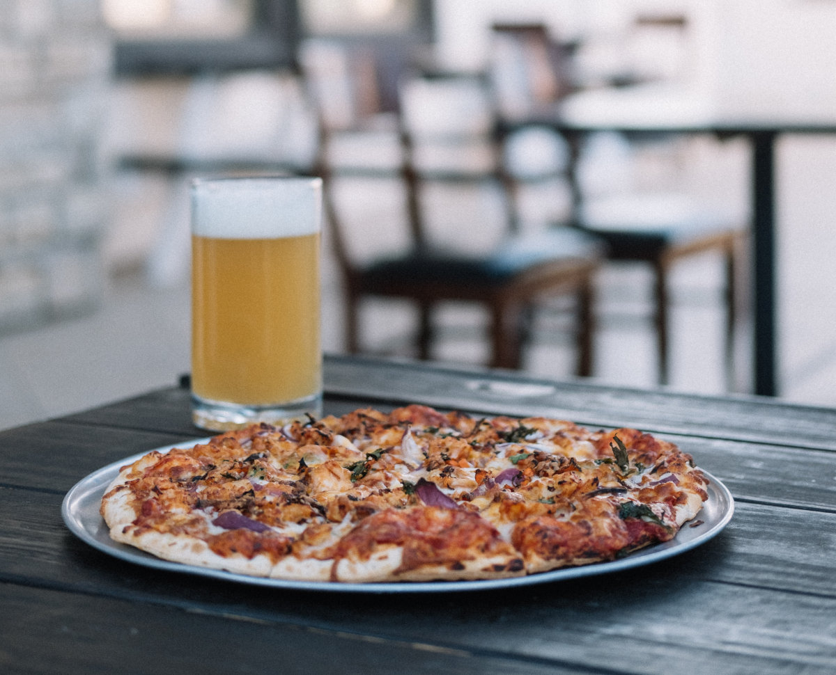 Two cold Blue Moon beers, a fully-loaded pizza and several delicious appetizers