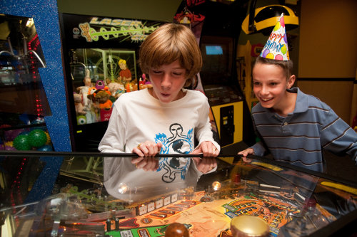 Boys playing pinball